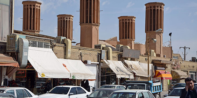 Windcatchers, busy street, Yazd