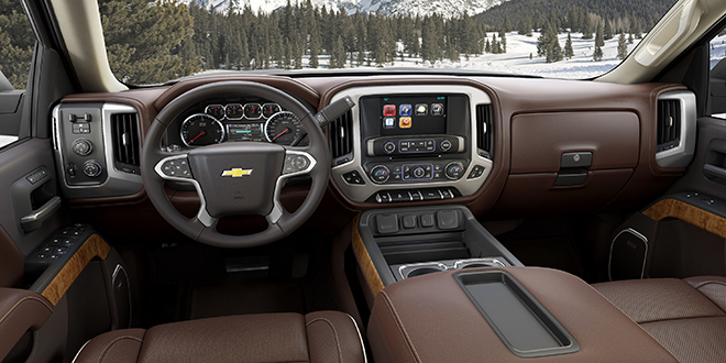 The interior of the 2014 Chevrolet Silverado High Country features an exclusive saddle brown interior, with authentic materials throughout. Features include heated and cooled perforated premium leather front bucket seats with High Country logos on the headrests, Chevrolet MyLink connectivity with an 8-inch touch screen, Bose premium audio and front and rear park assist.