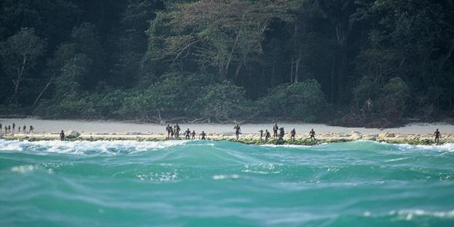 d sentinelese tribespeople gather on the shore of north sentinel i a Copy