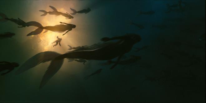 PIRATES OF THE CARIBBEAN: ON STRANGER TIDES Mermaids surround a longboat full of pirates from the Queen Anne's Revenge Photo Courtesy of Industrial Light & Magic ©Disney Enterprises, Inc. All Rights Reserved..