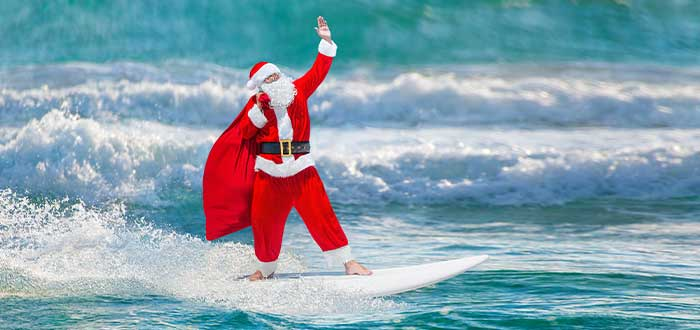 papa noel en tabla de surf tradiciones navideñas australianas